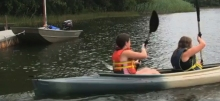 Two girl scouts kayaking